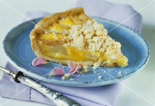 A slice of pear and vanilla crumble tart