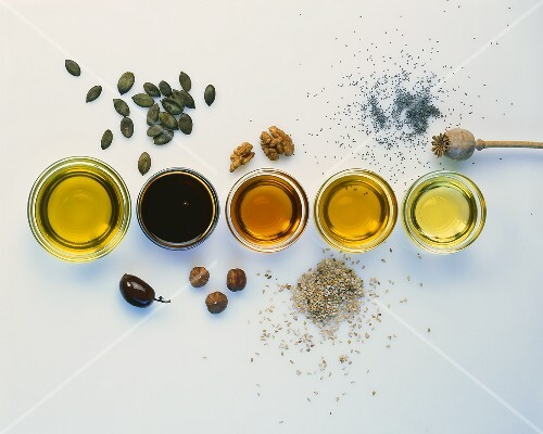 Various types of oil with the raw ingredients