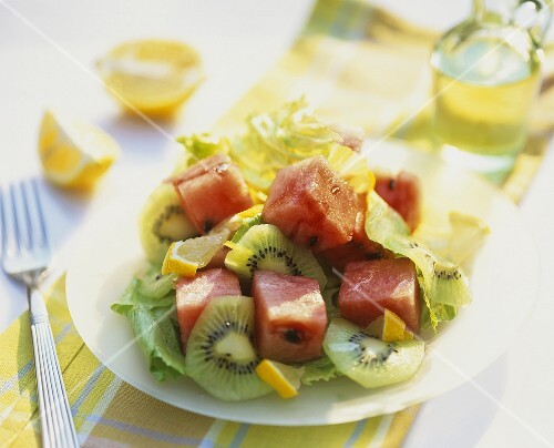 Lettuce with watermelon, kiwi fruit and lemon