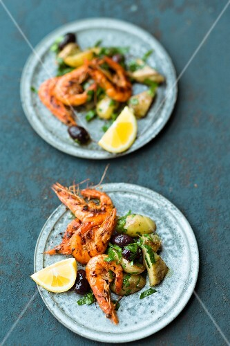 Spicy prawns with an artichoke and potato salad