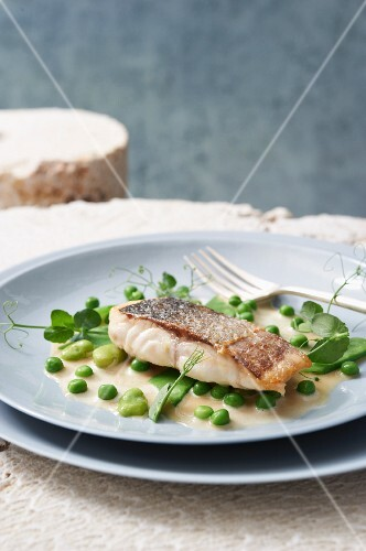 Seabass with an olive oil broth, peas and mange tout