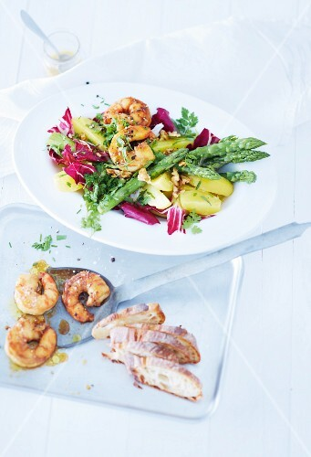 Potato salad with raddicchio and fried prawns
