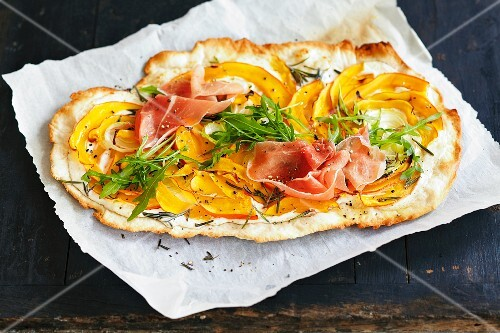 Tarte flambée with pumpkin and ham