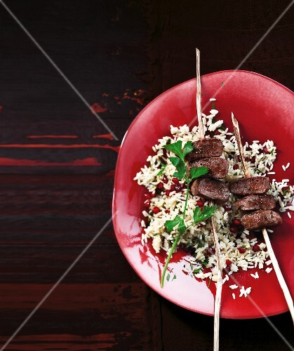 Pomegranate pilau with lamb skewers