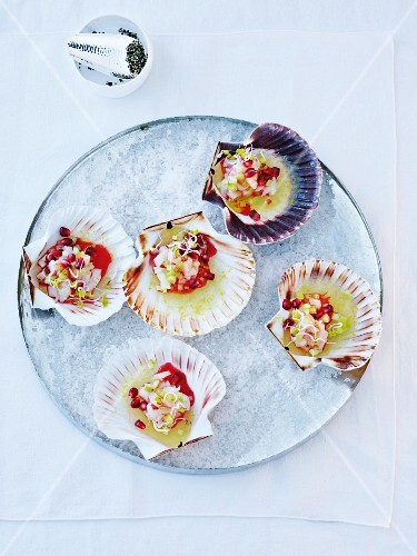 Scallop tartar on lemon jelly with pomegranate vinaigrette
