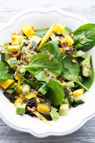 Spinach salad with avocado, mango and bean sprouts