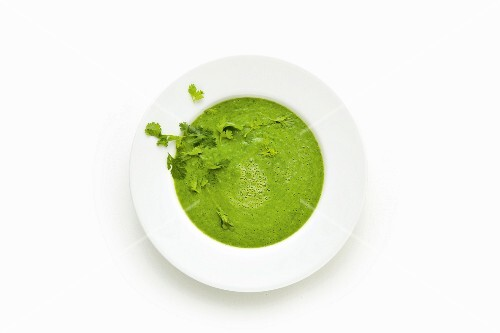Green soup made with avocado, spinach and moringa powder