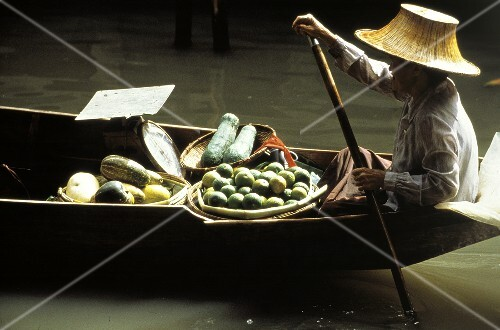 Asian Man with Vegetables and Fruit on Boat