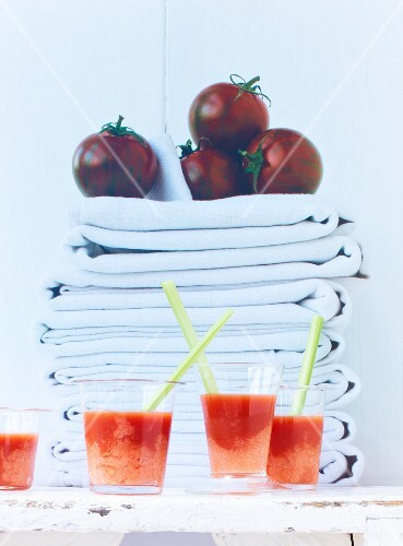 Bloody Marys made with tomato sorbet in front of a stack of cloths
