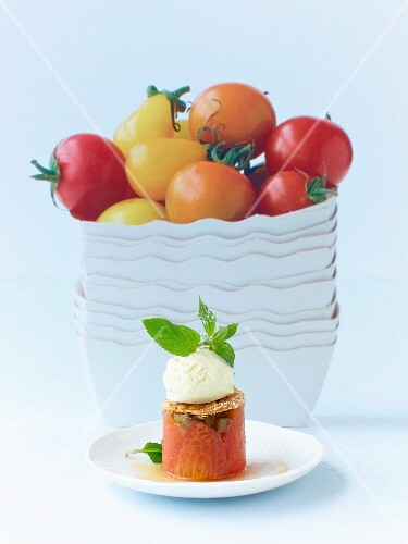 Candied tomatoes with aubergines and vanilla ice cream