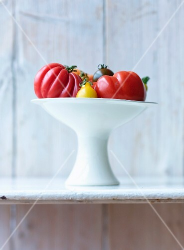 Various tomatoes in a white bowl