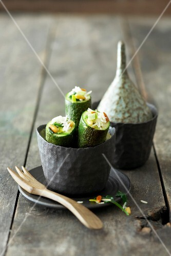 Zucchini with rice stuffing in metal bowl