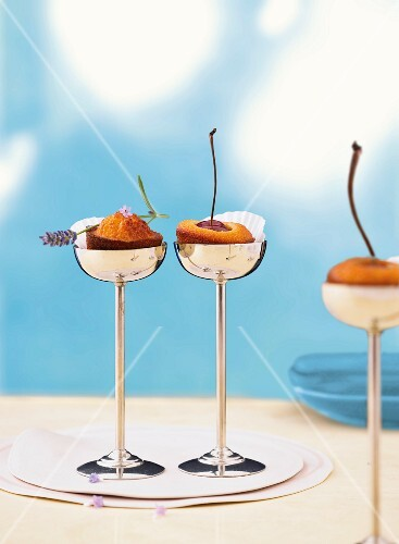 Three almond cakes with lavender and cherries in stemmed dessert cups