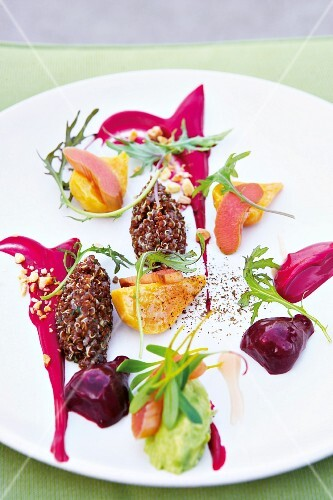 Salad with red quinoa, colourful beets and avocado