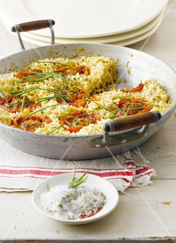 Fried brown rice and herb tomatoes