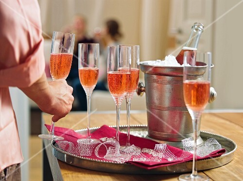 Glasses of rosé champagne on a tray
