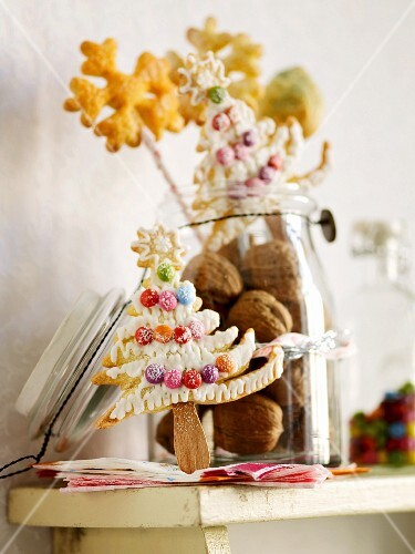 Tree and snowflake-shaped Christmas biscuits on sticks