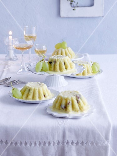 Pudding with apples, grapes and vanilla sauce