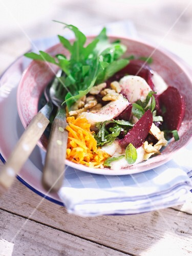 A beetroot salad with mozzarella and walnuts