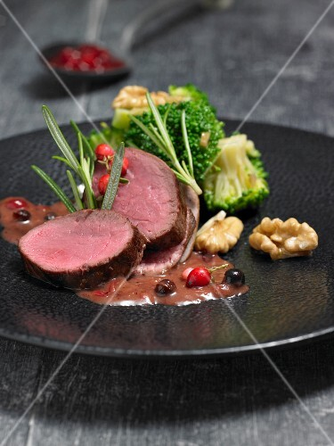 Signing of venison with juniper cream and walnuts
