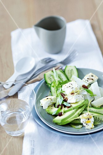 Cucumber and avocado salad with baked sheep's cheese