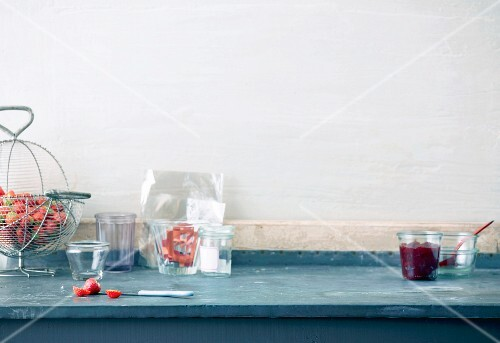 An arrangement of ingredients and utensils for making jam