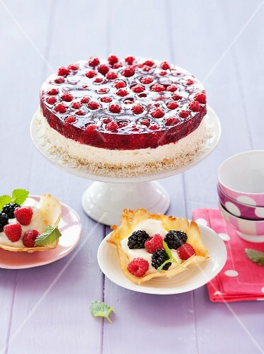 Raspberry cake with coconut and crispy tartlets with berries