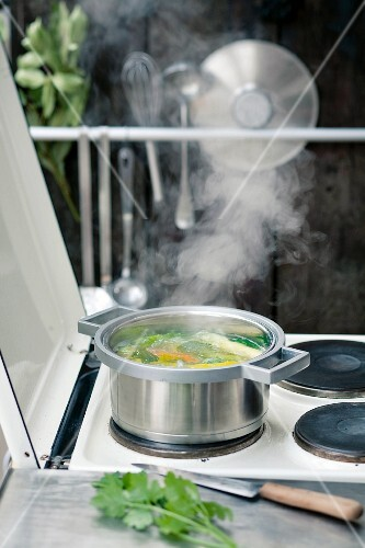 Vegetable broth on a stove outside