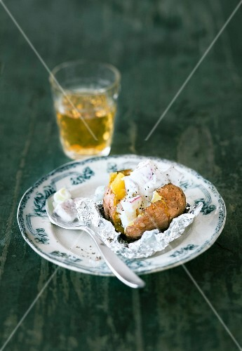 Baked potato with soused herring and sour cream