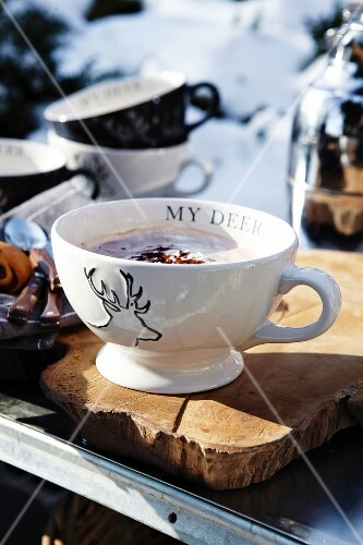 Hot chocolate in a cup with a stag motif