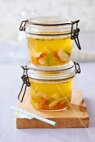 Homemade chicken soup in preserving jars