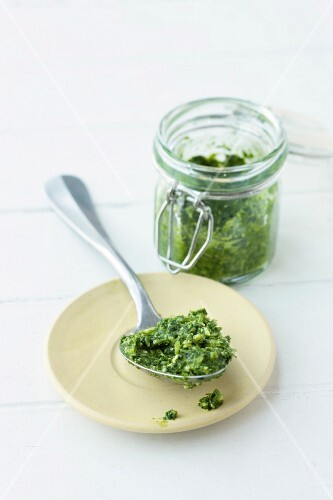 Pesto in a jar and on a spoon
