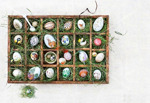 Easter eggs in a seedling tray lined with grass