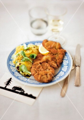 Viennese escalope with a potato and lamb's lettuce salad (Austria)