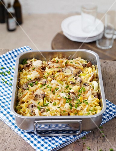 Cheese Spätzle (soft egg noodles from Swabia) with mushrooms in a baking dish