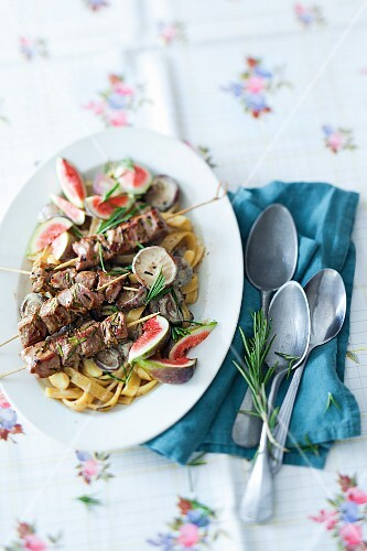 Mushroom fettuccine with figs and lamb skewers