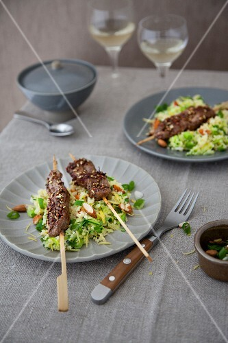 Lamb kebabs on a vegetable and bulgur salad