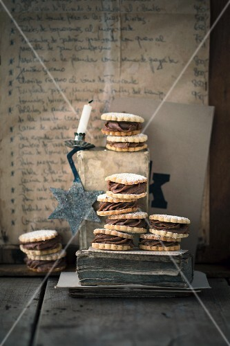 A stack of hazelnut sandwich biscuits with a chestnut filling