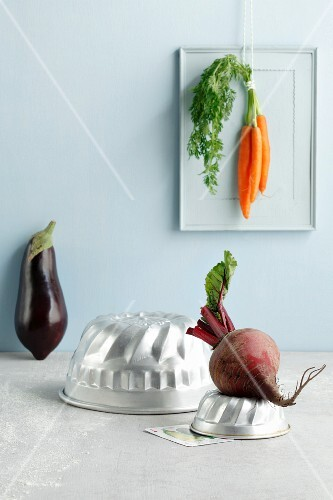 An arrangement of cake tins and vegetables