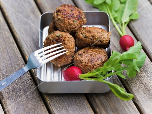 Meatballs with radishes in a lunch box