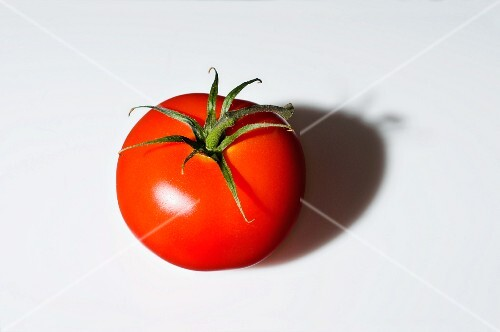 A tomato casting a shadow