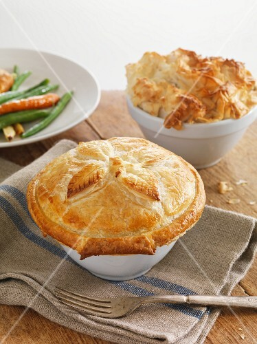 Two chicken pies in pie dishes