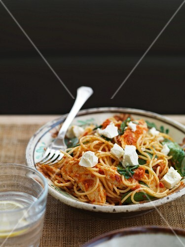 Spaghetti with chicken, tomato pesto and feta cheese