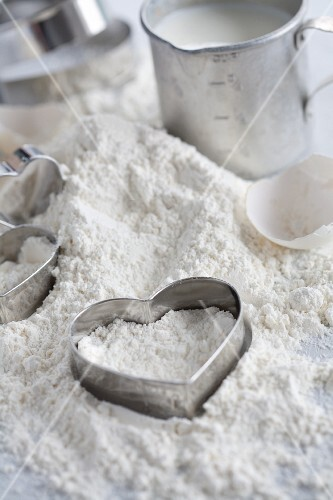 Baking ingredients and heart-shaped cutters