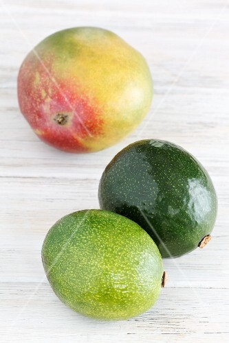 A mango and two avocados
