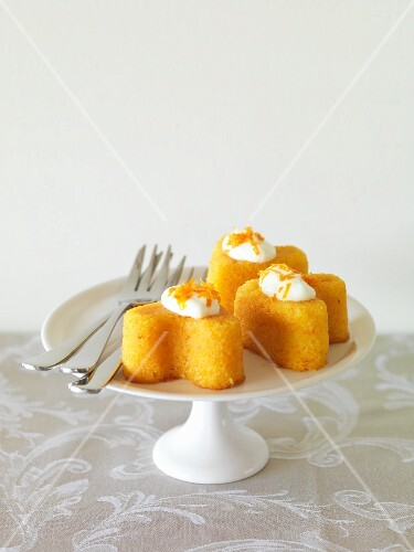 Mandarin and almond tartlets on a cake stand