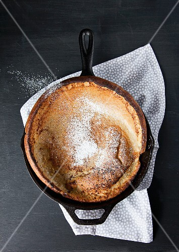 Dutch Baby Pan Cake in a Cast Iron Skillet with Powdered Sugar