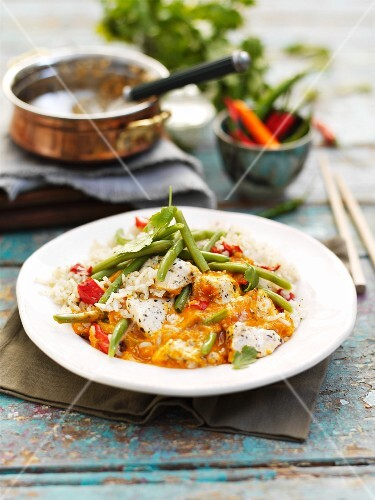 Red Thai curry with chicken and beans on a bed of fragrant rice