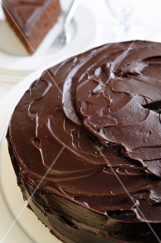 A chocolate cake topped with ganache