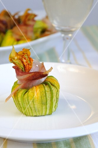 Stuffed courgette flowers tied with strips of bacon